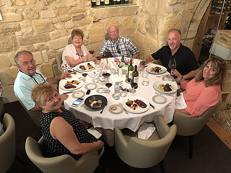 The 2018 June II Bordeaux Grand Cru Tour savoring a lovely lunch in Saint Emilion
