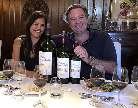 Ronald having fun with one of his guests on the 2018 June II Bordeaux Grand Cru Tour