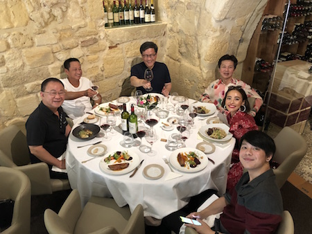 The 2018 Bordeaux Grand Cru Harvest Tour II enjoying a lovely lunch in Saint Emilion
