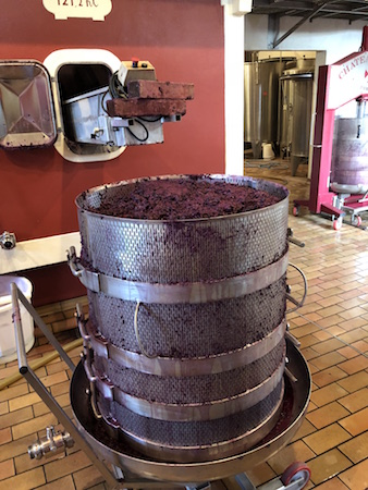 Seeing the wine press in action on the 2018 Bordeaux Harvest Tour III