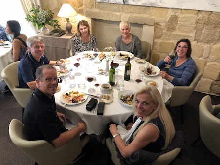 The 2018 Bordeaux Grand Cru Harvest Tour III enjoying a lovely lunch in Saint Emilion