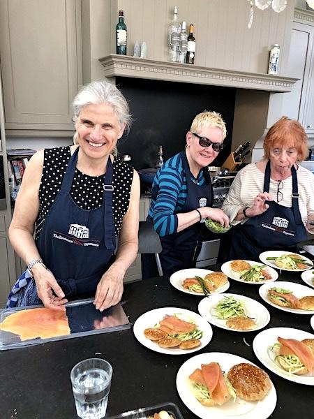 The June 2019 Grand Cru Tour 2 having fun in Margaret's Chateau Kitchen