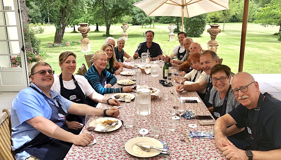The June 2019 Grand Cru Tour 2 enjoying the cooking experience in the chateau-kitchen